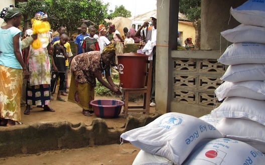 Observing hygiene while distributing food in Guinea. PHOTO Merel VANEGDOM