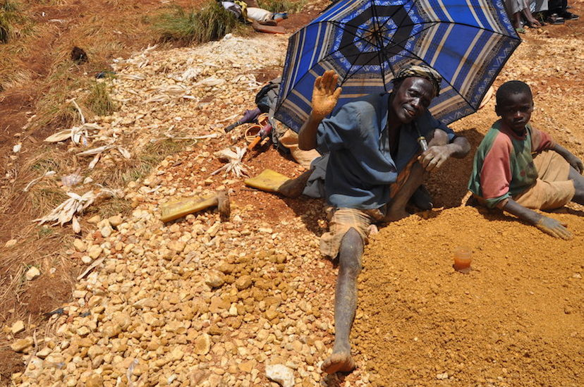 A man and his grandson scouring washed gravel for sapphire