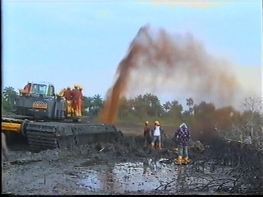 Shell workers arriving to clamp the broken pipeline, Bodo, 7 November 2008.  This still image taken from the film shot by local NGO, Centre for Environment, Human Rights and Development (CEHRD).  On 28 August 2008 a fault in the Trans-Niger pipeline resulted in a significant oil spill into Bodo Creek in Ogoniland. The oil poured into the swamp and creek for weeks, covering the area in a thick slick of oil and killing the fish that people depend on for food and for their livelihood. Thousands of barrels of oil spouted out of the broken pipeline for 10 weeks before Shell finally clamped it on 7 November 2008.  According to Shell, a total of 1,640 barrels of oil were spilled during the first spill. An independent assessment suggests that some 4,000 barrels poured out every day. (PHOTO: CEHRD)