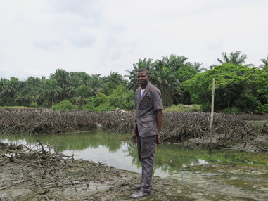 In 2008, the Bodo community, in the Niger Delta, was devastated by two massive oil spills from a Shell pipeline. In January 2015, Shell agreed to pay £55 million in compensation to the community. However, the pollution has still not been cleaned up.  Pastor Christian Lekoya Kpandei is a fish farmer from Bodo whose fish ponds were destroyed by the pollution. (PHOTO: Amnesty International)