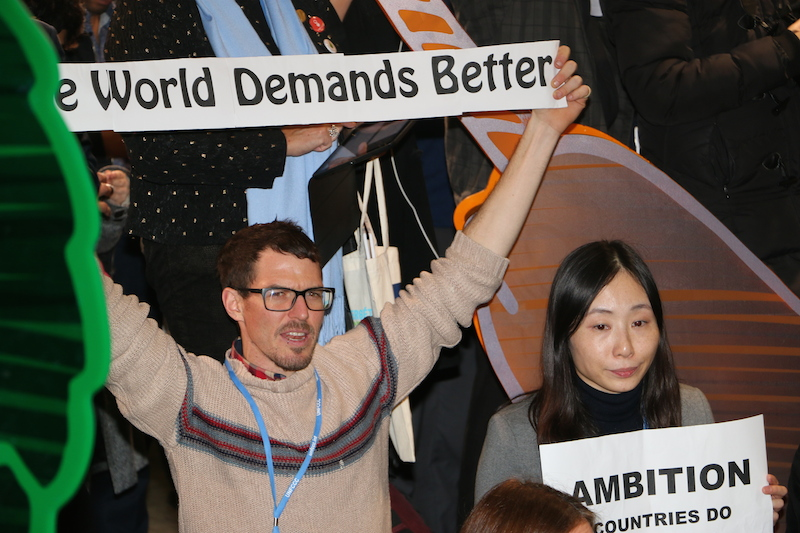 Civil society activist demanding a better deal from Paris (PHOTO: ClimateReporters/Atâyi Babs)