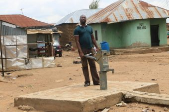 Ataka Terhemba at the dysfunctional public borehole in Iddo Sarki (PHOTO: Mimiola Olaoluwa)