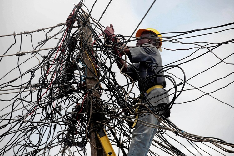 Power distribution lines for both metered and unmetered consumers in Nigeria (PHOTO: sweetcrudereports)