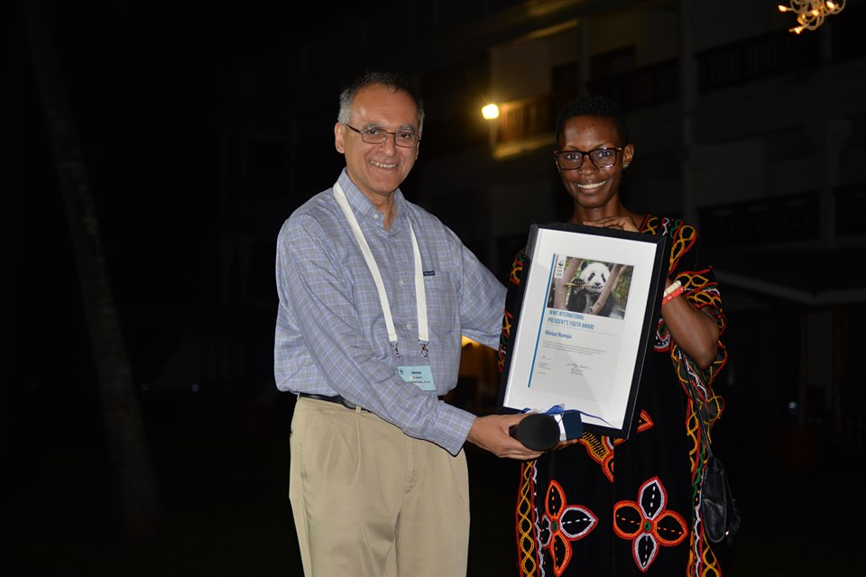 Monique Ntumngia receiving award